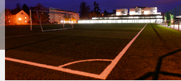 Unobtrusively illuminated football ground in front of the HSG provisional teaching facilities by night.